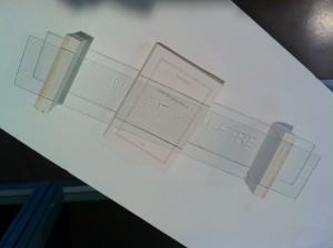 « sans titre », acrylique sur verre, assemblage avec le livre d'artiste de Denis Briand : « Nier des peut-être », éditions, 2007. 0mbre projetée, divers éléments, 2011